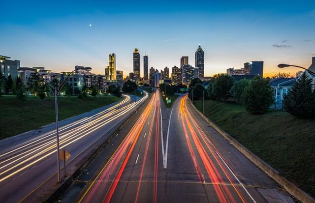 time-lapse-photography-of-road-near-town-185662